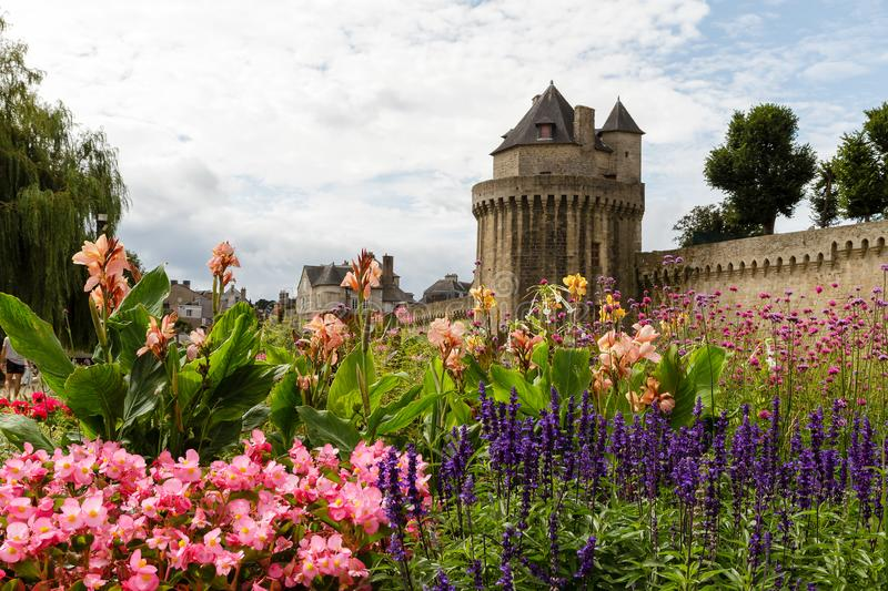 Ramparts and garden at Vannes, Brittany, France. Pretty gardens with medieval stone walled ramparts and tower at Vannes , Brittany, France stock photo