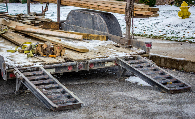 Ramps on a Construction Trailer. Ramps resting on a construction trailer with tool belt and wooden boards royalty free stock images