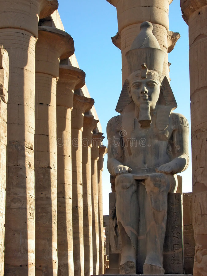 Ramses II watches over Luxor Temple, Egypt. Ramses II watches over Luxor Temple, on the east bank of the River Nile. Luxor, Egypt stock photos