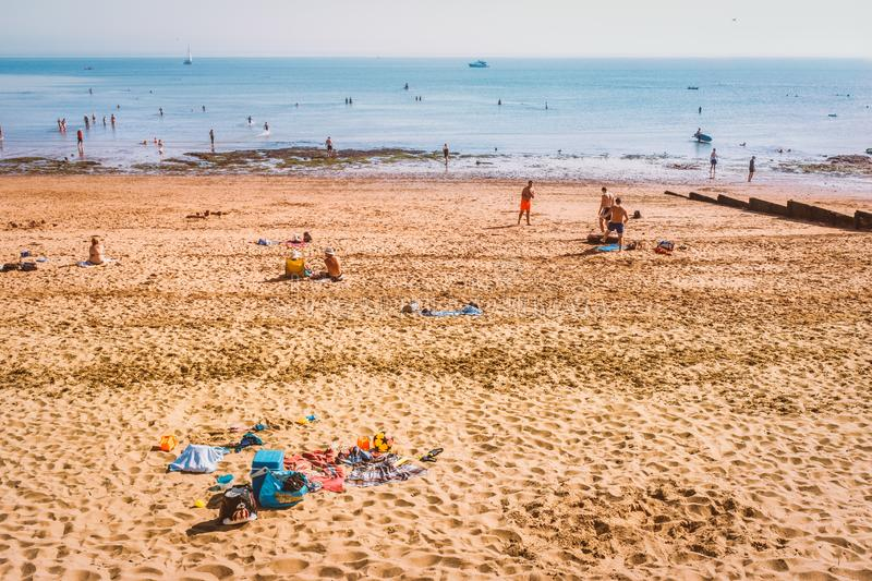 Glorious weather for the bank holiday as tourists and locals enjoy the Western Undercliff Beach. Ramsgate, UK - Aug 26 2019.  Glorious weather for the bank stock photography