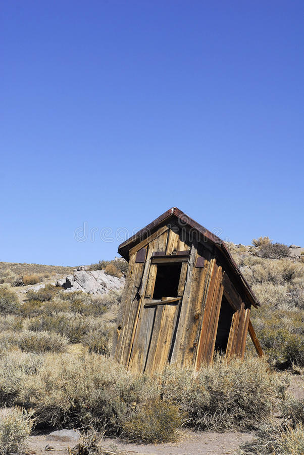 Ramshackle Outhouse. A dilapidated outhouse on the verge of collapse royalty free stock photography