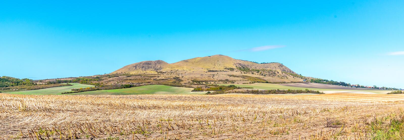 Rana Mountain near Louny in Central Bohemian Highlands on sunny summer day, Czech Republic. Panoramic view.  stock photography