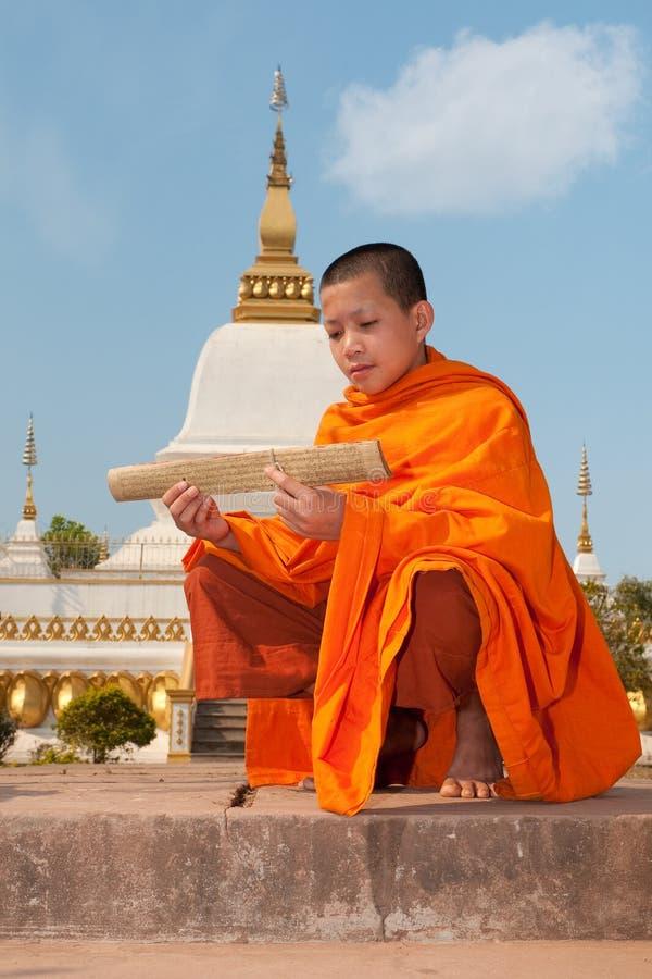 Rana pescatrice buddista nel Laos immagine stock libera da diritti