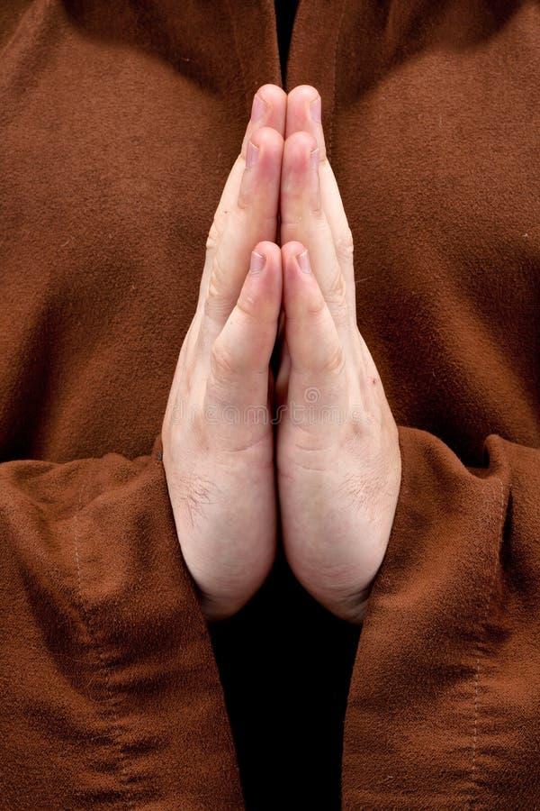 Rana pescatrice con due mani clasped nella preghiera immagine stock libera da diritti