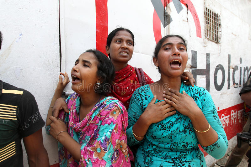 Rana plaza collapsed. At least thousand of garment workers have been found dead and thousands others injured after the 8-story building, Rana Plaza, collapsed in royalty free stock image