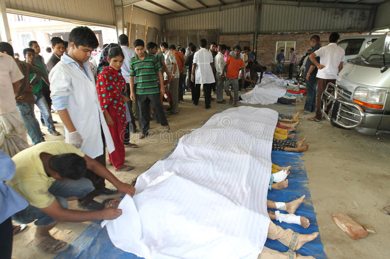 Rana plaza collapsed. At least thousand of garment workers have been found dead and thousands others injured after the 8-story building, Rana Plaza, collapsed in stock photos