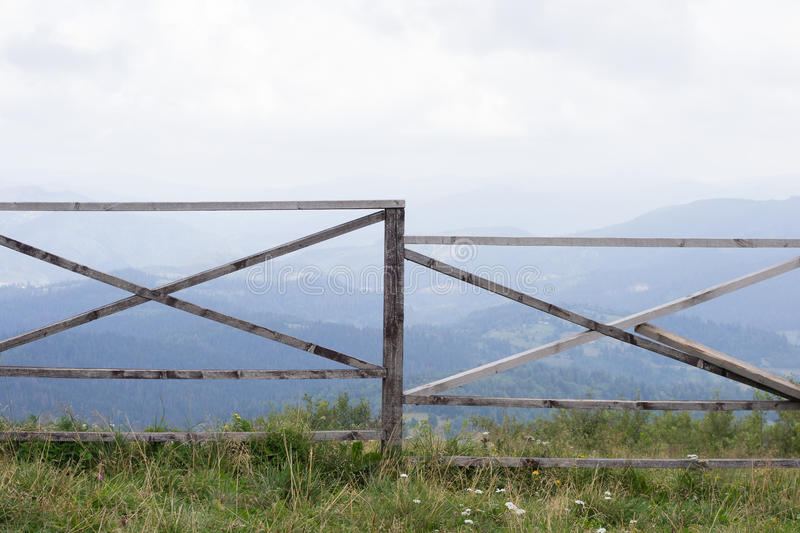 Ranch fence overlooking Carpathian Mountains royalty free stock photo