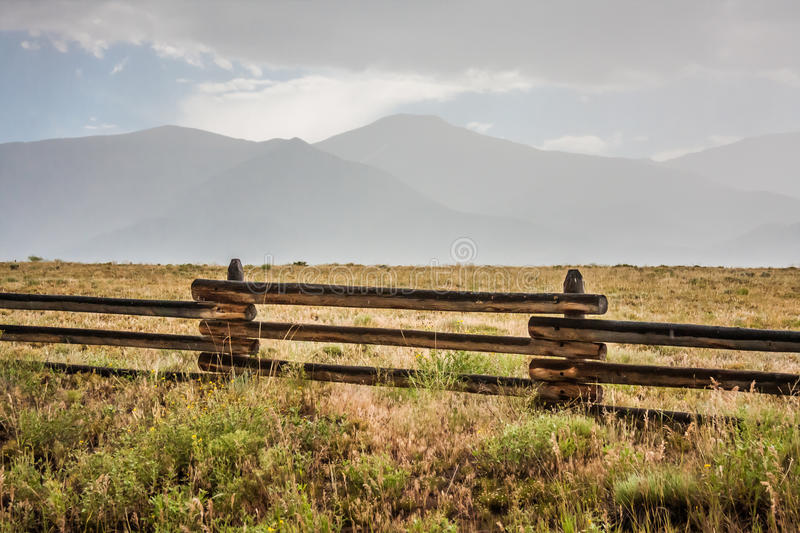 Ranch Land below the Sangre de Cristo Mountains. Ranch land with fence in foreground in the valley below the Sangre de Cristo Mountains in central Colorado on a stock photo