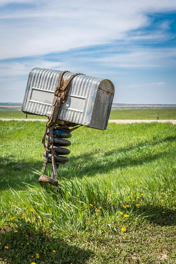 A rancher's old metal mailbox with a bridle wrapped around it in rural Saskatchewan, Canada stock photos