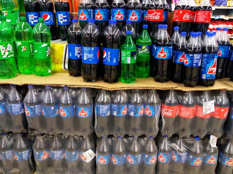 Selection of cold drinks products on shelves in a supermarket stock photos
