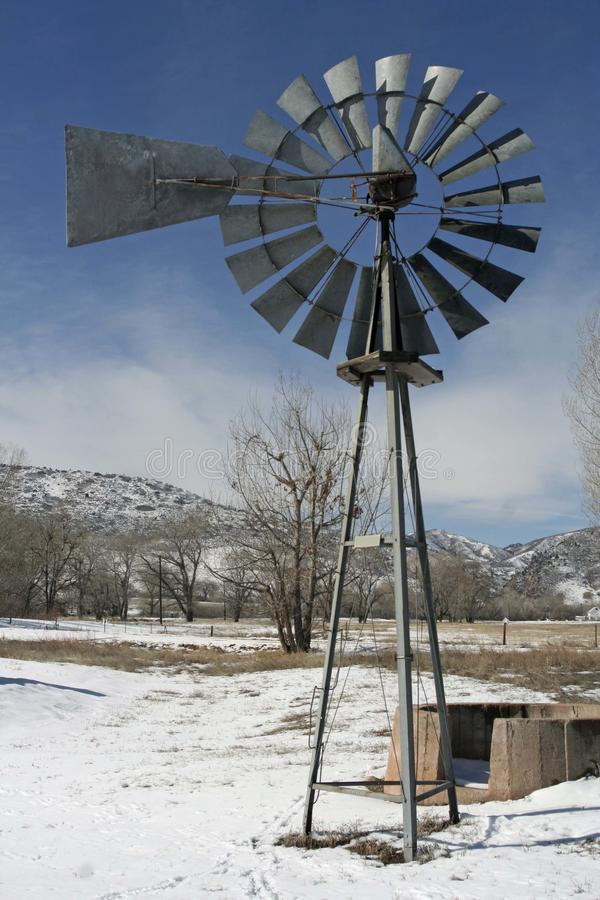 Ranching Along the Front Range. A windmill stands as a testament to the historic ranches that can be found along the Front Range of the Rocky Mountains royalty free stock photography