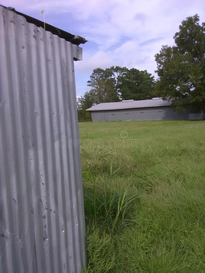 Ranching. Sheds on fields of green royalty free stock photos