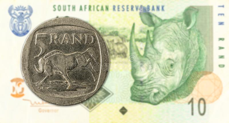 5 rand coin against 10 south african rand bank note obverse. Specimen stock photography