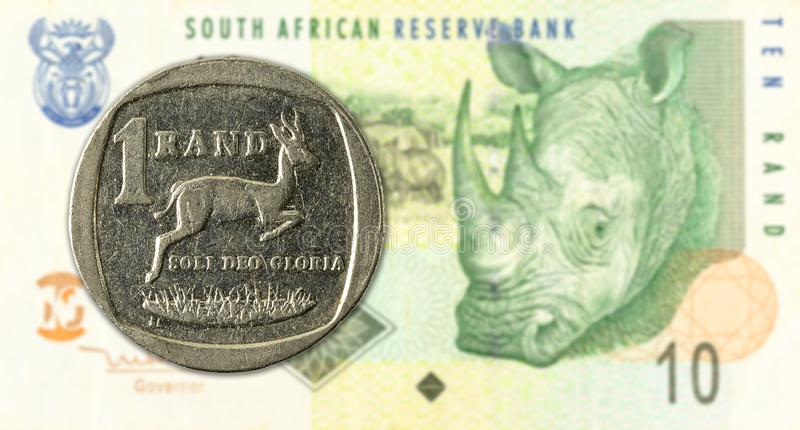 1 rand coin against 10 south african rand bank note obverse. Specimen royalty free stock photo