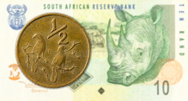 0,5 rand coin against 10 south african rand bank note obverse. Specimen royalty free stock images