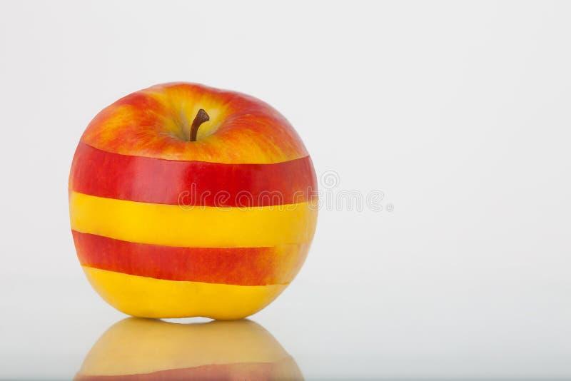 randig yellow för äpplered royaltyfri foto