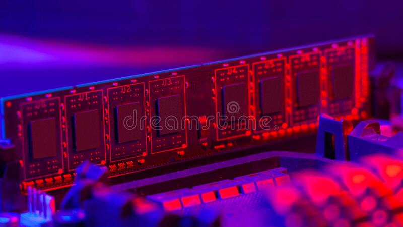 Random access memory.strip inserted into the motherboard. Motherboard out-of-the-box red-blue light. Computer components.  stock photo