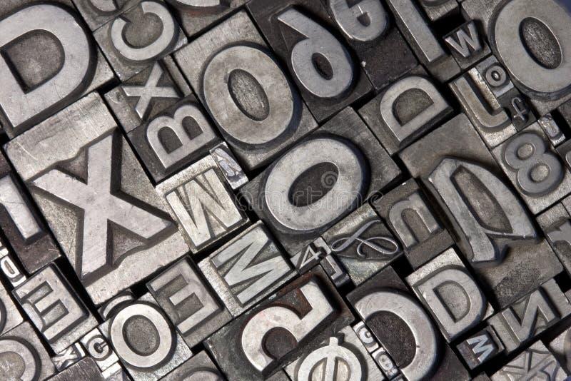 Random arrangement of letterpress lead letters royalty free stock photo