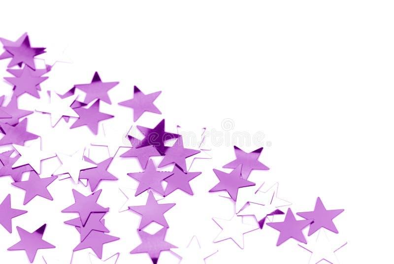 A random arrangement of purple confetti stock image