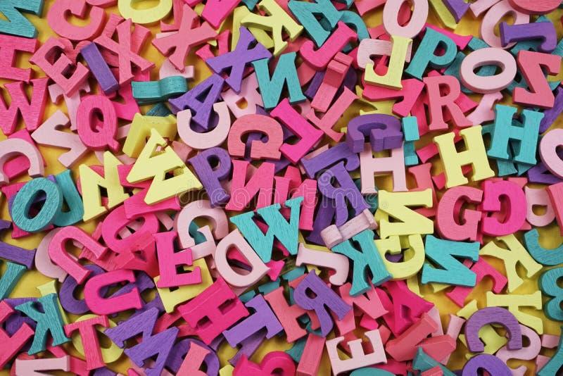 Random colorful letterpress alphabet with space copy top view. Top view OF random colorful letterpress alphabet with space copy royalty free stock image