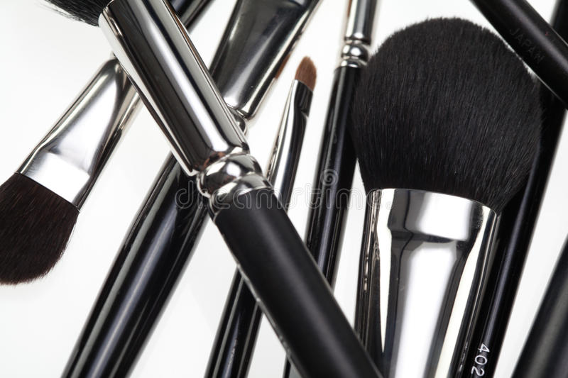 Random composition with make-up brushes stock photos