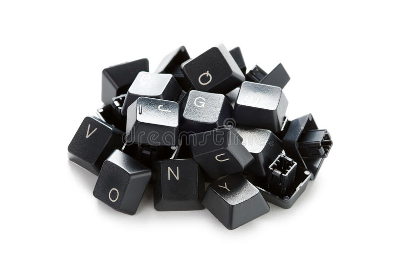 Random computer keys in a heap. A pile of computer keyboard keys isolated on a white background royalty free stock image
