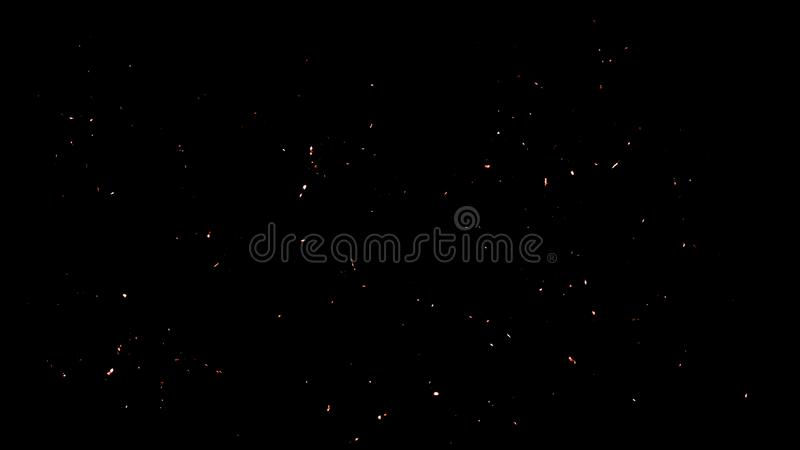 Random fire ember flying fire sparks particles isolated on the black background for overlay design. Fire debris particles embers texture on background overlays royalty free stock photos