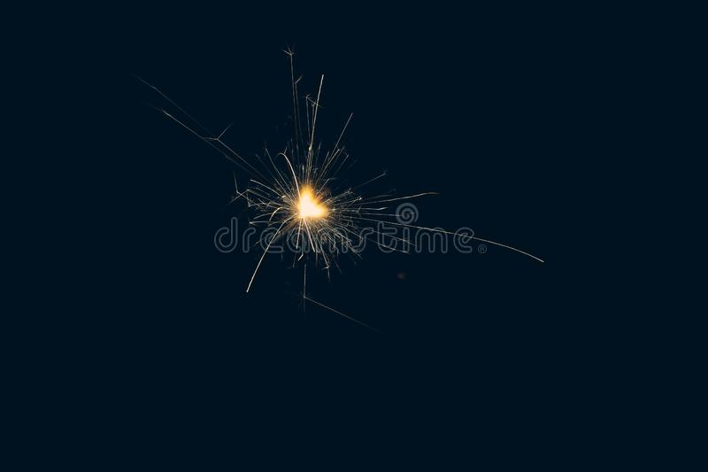 Random fire sparkles during New year holiday stock photography