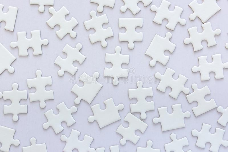 Random Layout of Jigsaw Puzzle on White Background, Abstract Idea Concept stock images