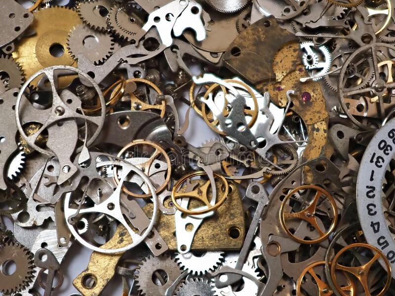 Random Pile of Old Mechanical Watch Parts. A random pile of small metal components, gears and wheels, from disassembled wristwatches and small clocks. Can be royalty free stock photography