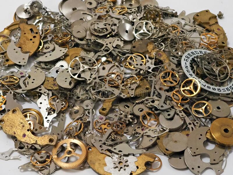 Random Pile of Old Mechanical Watch Parts. A random pile of small metal components, gears and wheels, from disassembled wristwatches and small clocks. Can be stock photo