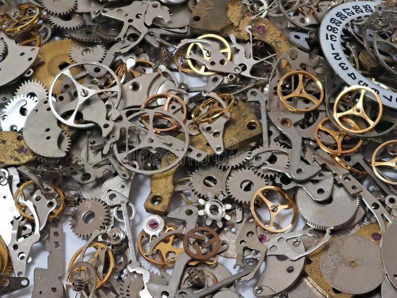 Random Pile of Old Mechanical Watch Parts. A random pile of small metal components, gears and wheels, from disassembled wristwatches and small clocks. Can be stock image