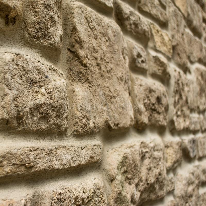 Random rubble stone wall. Close up image of a new panel of stone walling stock photo