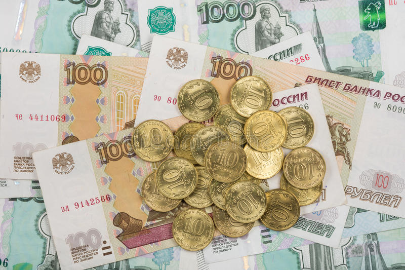 On randomly scattered banknotes Russian rubles is a bunch of ten-coin royalty free stock image