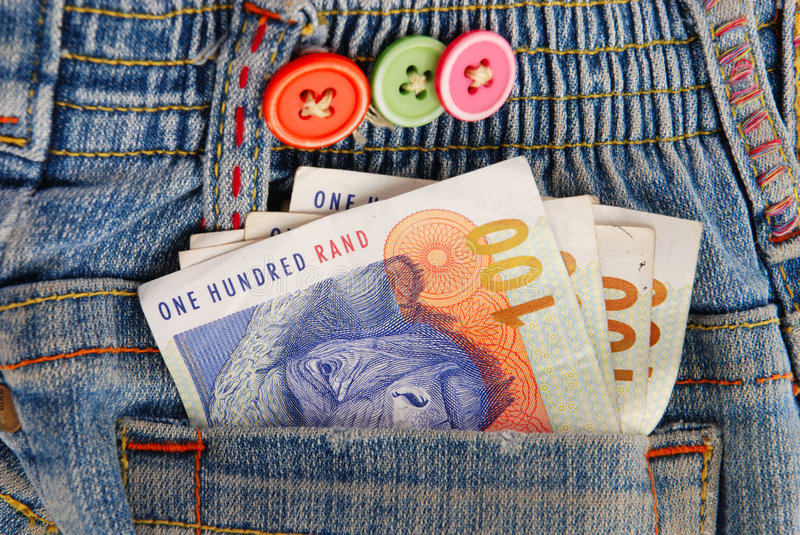 South Africa Rand money in pocket. Notes of South African Rand money in the pocket of a kids blue jeans royalty free stock photo