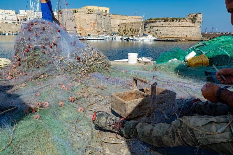 Ranek krajobrazowa fotografia robić w Gallipoli molu, rybaka repari obrazy royalty free