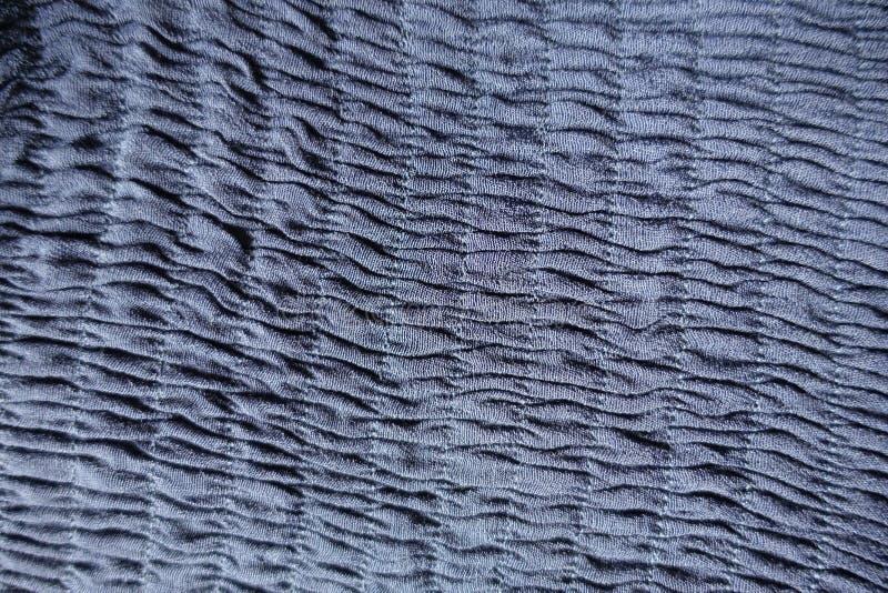 Rangées verticales des rassemblements sur le tissu bleu photo libre de droits
