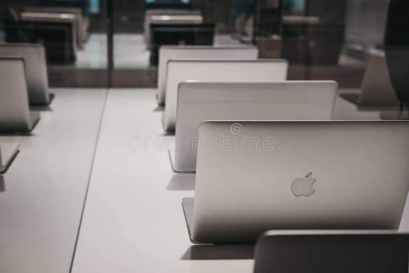Range of MacBooks on display inside Apple Museum in Prague,Czech Republic stock images