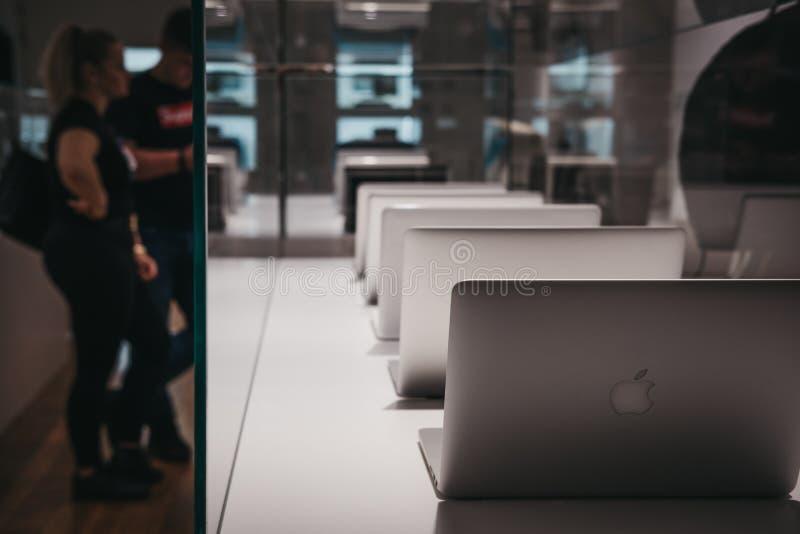 Range of MacBooks on display inside Apple Museum in Prague,Czech Republic royalty free stock photo