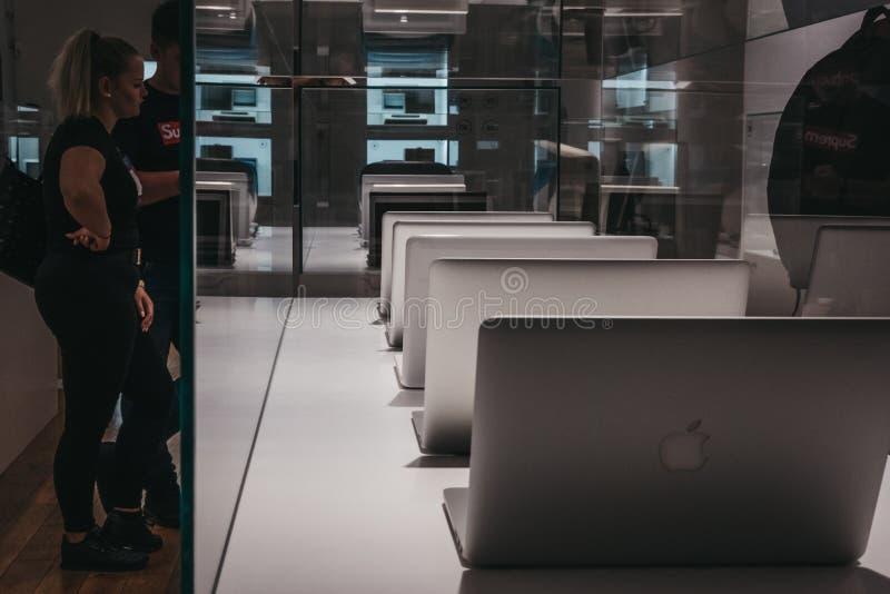 Range of MacBooks on display inside Apple Museum in Prague,Czech Republic royalty free stock photos