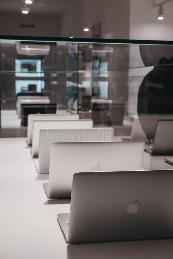 Range of MacBooks on display inside Apple Museum in Prague,Czech Republic. Prague, Czech Republic - August 28, 2018: Range of MacBooks on display inside Apple stock photography