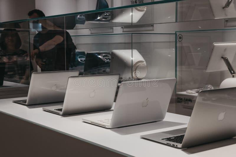 Range of MacBooks on display inside Apple Museum in Prague,Czech Republic stock photography
