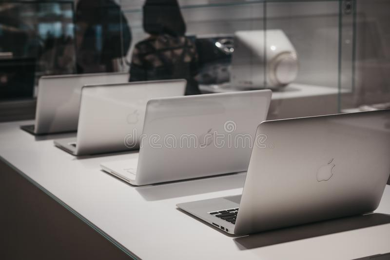 Range of MacBooks on display inside Apple Museum in Prague,Czech Republic. Prague, Czech Republic - August 28, 2018: Range of MacBooks on display inside Apple stock images