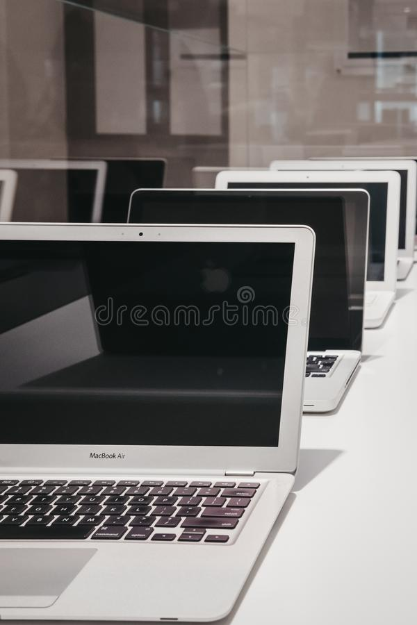 Range of MacBooks on display inside Apple Museum in Prague,Czech Republic. Prague, Czech Republic - August 28, 2018: Range of MacBooks on display inside Apple stock photo