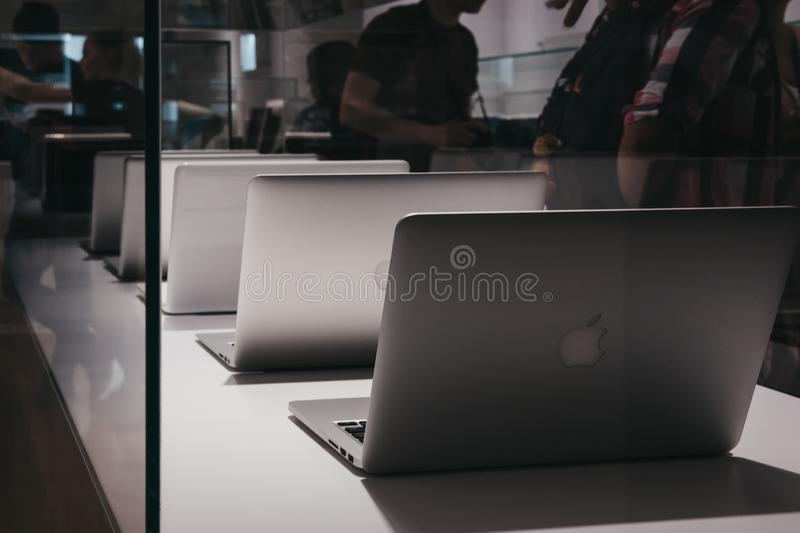Range of MacBooks on display inside Apple Museum in Prague,Czech Republic. Prague, Czech Republic - August 28, 2018: Range of MacBooks on display inside Apple royalty free stock images