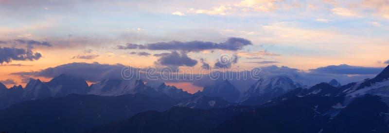 Range of the mountains on sundown