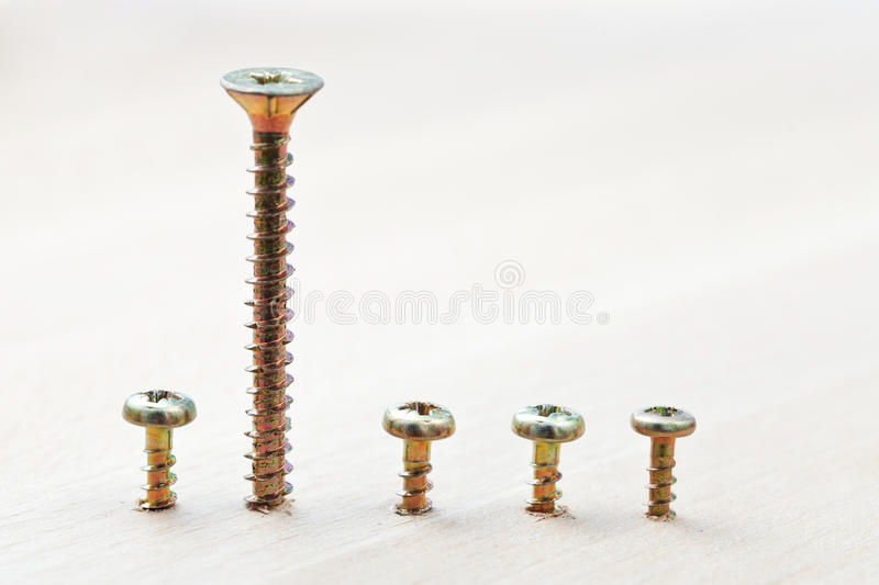 Download Range Of Screws Wraped In Wooden Plank Stock Image - Image: 33662389