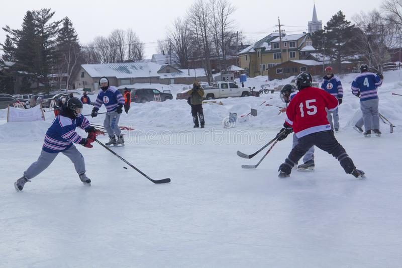 Men`s teams compete in a Pond Hockey Festival in Rangeley. Rangeley, Maine, USA - February 4, 2017: Men`s teams compete on the ice at the 11th annual New stock image