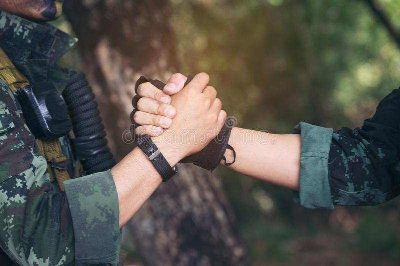 Rangers celebrating success, clapping with hands. Team work conceptual image. Soldier shaking hands . People and military concept royalty free stock images