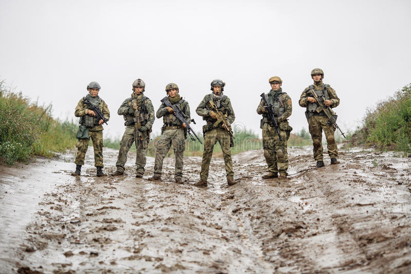 Rangers team standing with rifle and looking at camera royalty free stock images